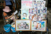 A portrait artist draws a young customer at the Art Market inside Inokashira Park in the trendy neighborhood of Kichijoji in Musashino City, Tokyo, Japan on 16 Sept. 2012.  Photographer: Robert Gilhooly