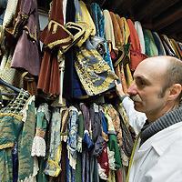 VENICE, ITALY - JANUARY 20: Master tailor Francesco Briggi of the historic atelier Pietro Longi talks about a costume on January 20, 2012 in Venice, Italy. This is one of the busiest periods of the year for the atelier as the next few weeks the streets and canals of Venice will be filled with people attending the carnival, wearing highly-decorative and imaginative carnival costumes and masks.