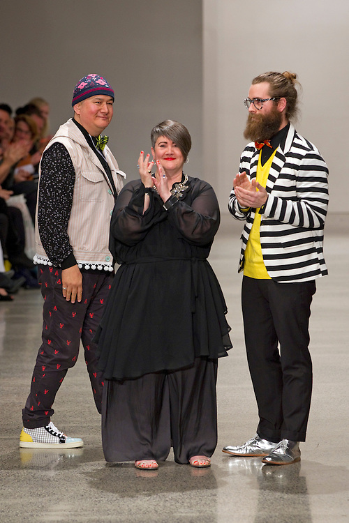World collection team Francis Hooper, left,  Denise L'Estrange Corbet and Bennie Castles acknowledge the audience after their show at New Zealand Fashion Week, Viaduct Events Centre, Auckland, New Zealand, Friday, September 02, 2011.  Credit:SNPA / David Rowland
