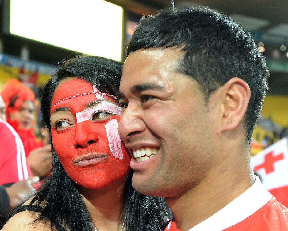 Tonga's Siale Piutau with a fan after their win over France in the Rugby World Cup pool match at Wellington Stadium, Wellington, New Zealand, Saturday, October 01, 2011. Credit:SNPA / Ross Setford