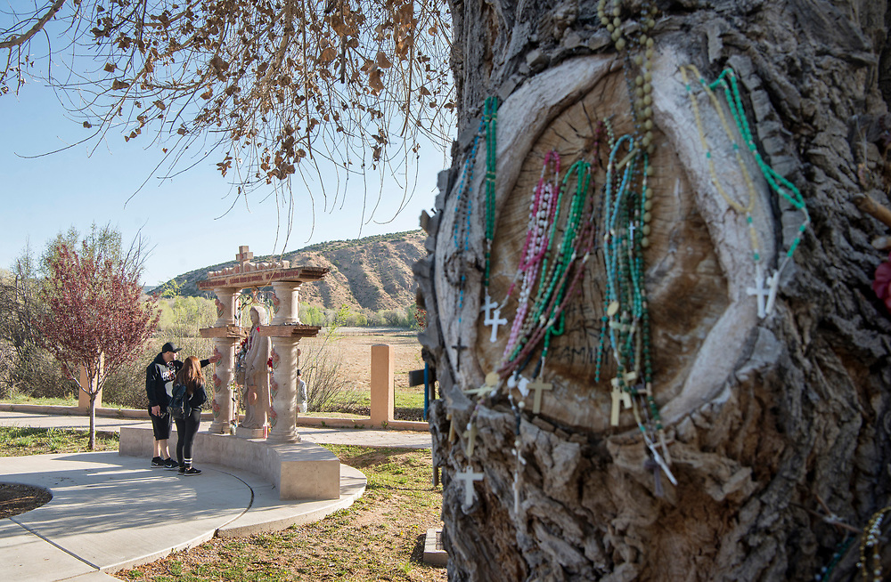 em041417d/a/Juan Bojorquez and Monica Rodriguez, from Espanola look at a Stations of the Cross behind Santuario de Chimayo, Friday April 14, 2017. With beautiful weather, thousands of people were making the Good Friday pilgrimage to the Northern New Mexico church.  (Eddie Moore/Albuquerque Journal