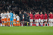 Arsenal and Blackpool players shake hands before during the EFL Cup 4th round match between Arsenal and Blackpool at the Emirates Stadium, London, England on 31 October 2018.