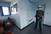 Panmunjom. Joint Security Area. South Korean guard posing with fierce looks on the North Korean side of the barrack.