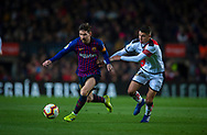 Leo Messi of FC Barcelona (left)runs away from Santi C.V. during the Spanish league football match of 'La Liga'  FC BARCELONA against RAYO VALLECANO at Camp Nou Stadium of Barcelona on March 9,2019