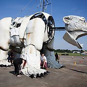 Peter Elliott, actor and primate animator expert, trains the puppeteers and volunteers of the day. The giant polar bear Aurora is test run on North Weald Airfield near Epping. It is the first day that puppeteers get a chance to get her legs and feet moving. Aurora, a double-decker-bus-size polar bear puppet specially commissioned by Greenpeace to lead an Arctic-inspired street parade to the London HQ of oil giant Shell on 15 September. The three-tonne marionette bear will be operated from the inside by a team of 15 puppeteers, including artists from West End blockbuster War Horse, and will be hauled on ropes by 30 volunteers along a route including the Houses of Parliament and Westminster Bridge.