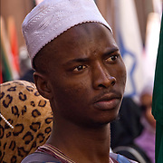 Portrait of the African Muslim  male from West Africa wearing white skull cap (head covering) at the American Muslim Day Parade in New York City