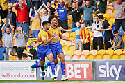 Mansfield Town forward Lee Angol (9) celebrates his goal during the EFL Sky Bet League 2 match between Mansfield Town and Luton Town at the One Call Stadium, Mansfield, England on 26 August 2017. Photo by Nigel Cole.
