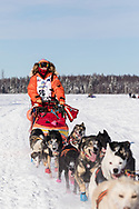Musher Meredith Mapes after the restart in Willow of the 46th Iditarod Trail Sled Dog Race in Southcentral Alaska.  Afternoon. Winter.