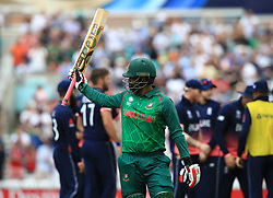 Bangladesh's Tamim Iqbal acknowledges the crowed after being dismissed for 128, caught by England's Jos Buttler, during the ICC Champions Trophy, Group A match at The Oval, London.