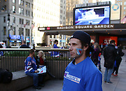 April 24, 2015 - New York, NY. A Rangers fan gets waits for friends prior game 5 of the Rangers-Penguins series.  Photograph by Anthony Kane/NYCity Photo Wire