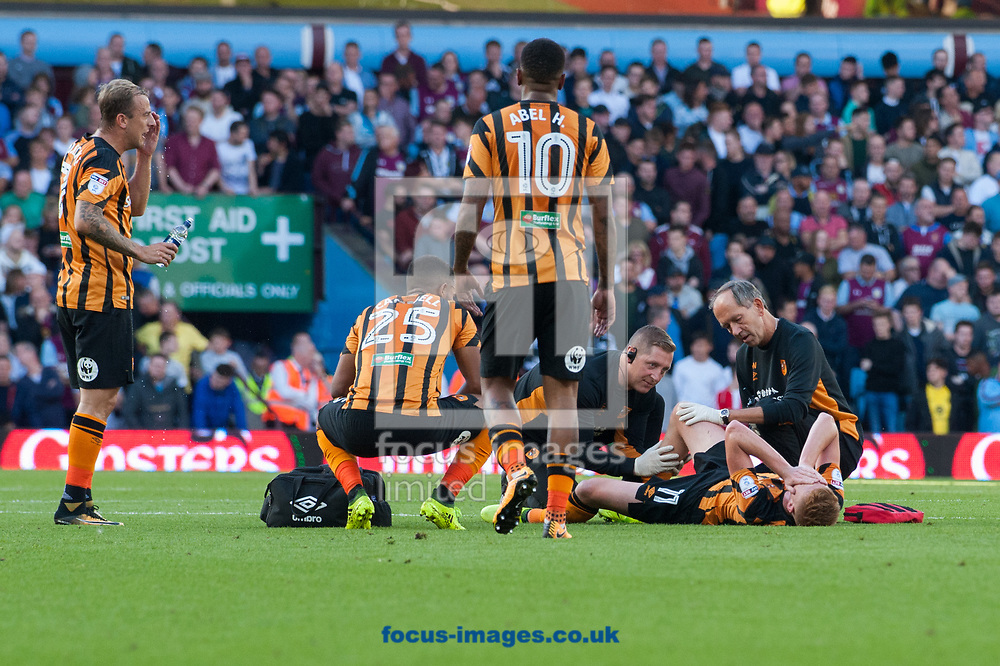 Sam Clucas of Hull Cityreceives treatment after being  fouled by Glenn Whelan of Aston Villa during the Sky Bet Championship match at Villa Park, Birmingham<br /> Picture by Matt Wilkinson/Focus Images Ltd 07814 960751<br /> 05/08/2017