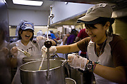 Image IMG_8036.jpg -Hisako Inomatu, right, a graduate student studying international development, works with Toshiko Kobayashi, left, freshman studying journalism, while making miso soup while preparing for the International Student Union's annual International Dinner on Saturday afternoon in the Jefferson Dining Hall. The dinner, which was Saturday night was prepared by sixty students, along with Chef Matt Ropposelli. They created 33 dishes which would be served to 500 people.
