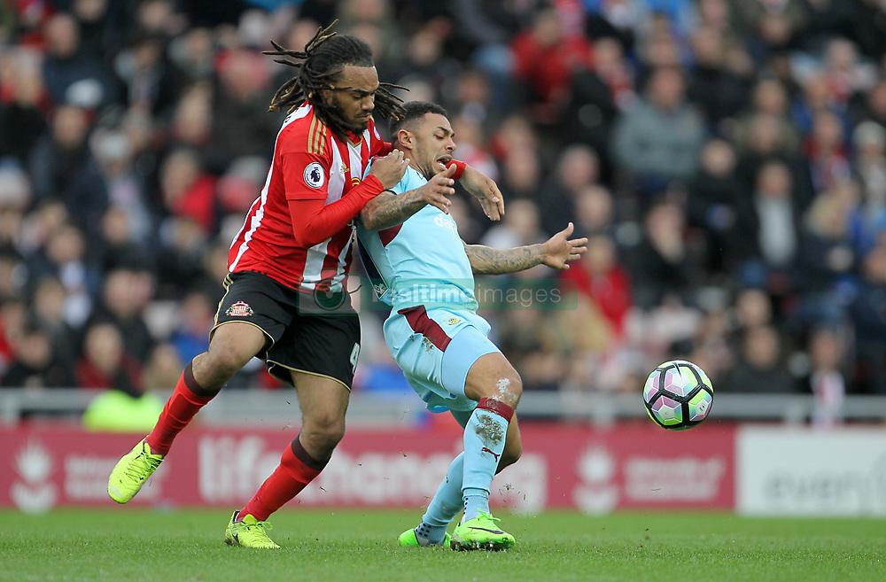 Sunderland's Jason Denayer (left) and Burnley's Andre Gray battle for the ball