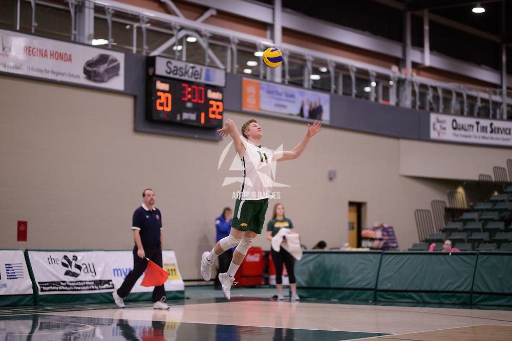 4th year setter Michael Corrigan (11) of the Regina Cougars in action during Men's Volleyball home game on February 3 at Centre for Kinesiology, Health and Sport. Credit: Arthur Ward/Arthur Images