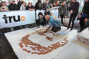 Sculptor Andy Gertler attempts to build the world's largest marshmallow mosaic at the truTV & GUINNESS WORLD RECORDS event celebrating the premiere of the Guinness World Records Unleashed series, in New York's Times Square, Wednesday, Nov. 6, 2013. (Photo by Diane Bondareff/Invision for Turner Broadcasting Inc/AP Images)