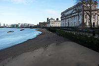Royal Naval College, Greenwich, looking west along the Thames foreshore, showing the Thames Path in front of the Admiral's House. London, England.