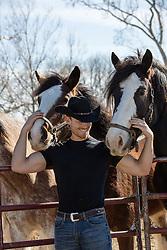 cowboy enjoying horses on a ranch