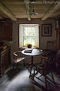 Table and two chairs set in a window in an old cottage in Wales