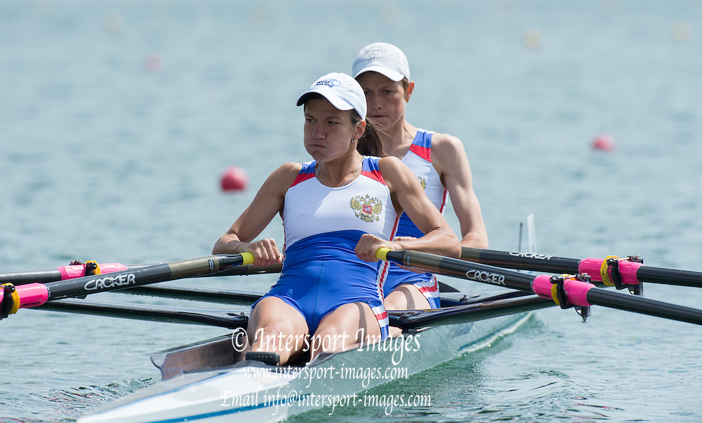 Belgrade, SERBIA,  RUS LW2X. Bow Diana STEPOCHKINA and Olga ARKADOVA at the start of their heat  at the2014 FISA European Rowing Championships. Lake Sava. <br /> <br /> <br /> 10:25:04  Friday  30/05/2014<br /> <br /> [Mandatory Credit; Peter Spurrier/Intersport-images]