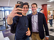 25 APRIL 2019 - DES MOINES, IOWA: US Representative SETH MOULTON (D-MA), poses for a selfie with a student in the lobby of Central Academy. Rep. Moulton visited Central Academy in Des Moines Thursday to talk to high school students and the school's JROTC class about public service. Moulton, a US Marine veteran who served in Iraq, is running to be the Democratic candidate for the US Presidency in 2020. Iowa traditionally hosts the the first selection event of the presidential election cycle. The Iowa Caucuses will be on Feb. 3, 2020.            PHOTO BY JACK KURTZ