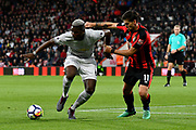 Paul Pogba (6) of Manchester United holds off Charlie Daniels (11) of AFC Bournemouth during the Premier League match between Bournemouth and Manchester United at the Vitality Stadium, Bournemouth, England on 18 April 2018. Picture by Graham Hunt.