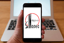 Using iPhone smartphone to display logo of Sinopec Chinese oil and gas company