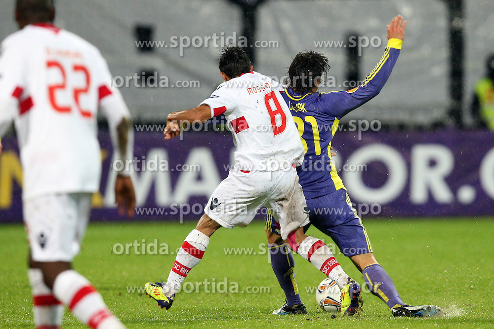 Zoran Lesjak of NK Maribor and Mossoro of NK Braga at 3th round of European Leauge football match between Nk Maribor and Nk Braga, November 20, 2011, in Maribor, Slovenia (Photo by Urban Urbanc / Sportida ) .