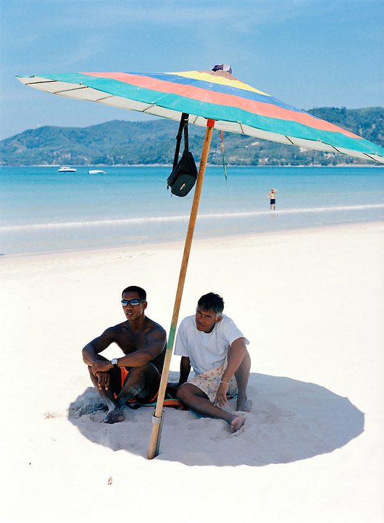 Catching some shade on Patong Beach