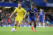 Bristol Rovers forward Matt Taylor (10) and Chelsea striker Michy Batshuayi (23) battles for possession during the EFL Cup match between Chelsea and Bristol Rovers at Stamford Bridge, London, England on 23 August 2016. Photo by Matthew Redman.