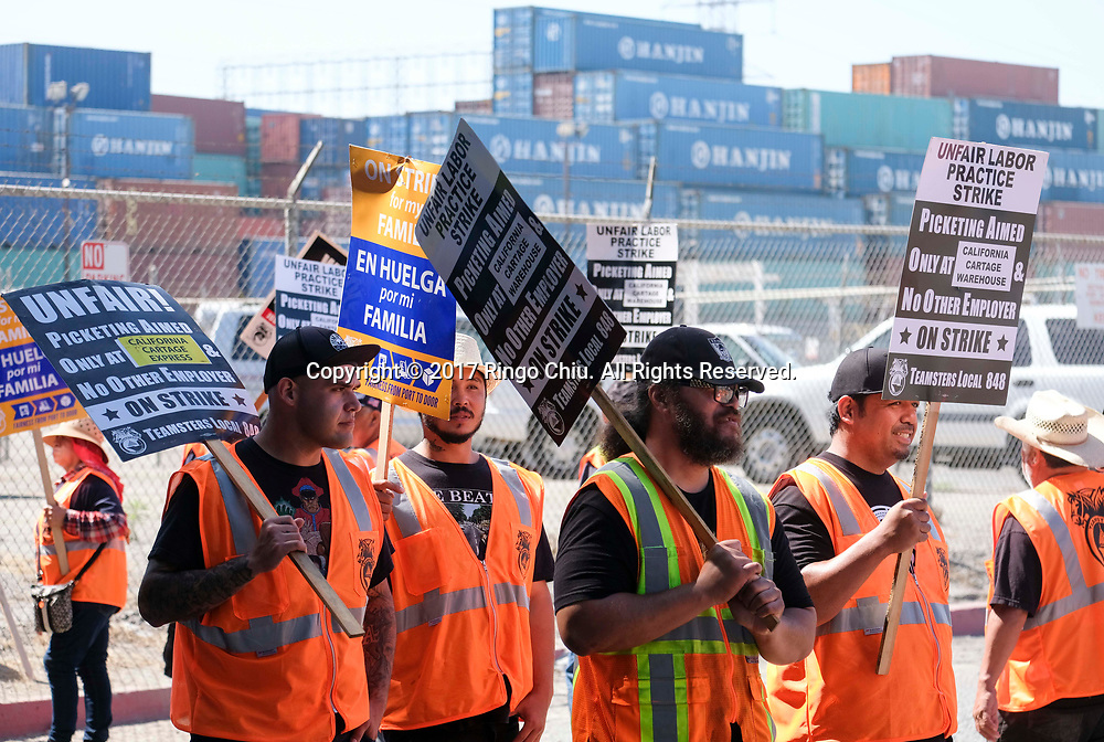 Warehouse workers and truck drivers on a picket line during a strike at the Port of Long Beach, California.(Photo by Ringo Chiu)<br /> <br /> Usage Notes: This content is intended for editorial use only. For other uses, additional clearances may be required.