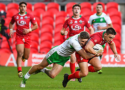 11th November 2018 , Racecourse Ground,  Wrexham, Wales ;  Rugby League World Cup Qualifier,Wales v Ireland ; James Olds of Wales is tackled by Ethan Ryan of Ireland <br /> <br /> <br /> Credit:   Craig Thomas/Replay Images