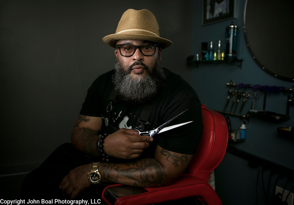 "Reggie ""Hollywood the Barber"" Blagmon, inside his studio space in Laurel, MD. He boxed throughout his youth and 29 years ago became a barber, inspired by his father's ""dapper style"". John Boal Photography"