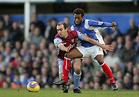 Photo: Lee Earle.<br /> Portsmouth v Aston Villa. The Barclays Premiership. 02/12/2006. Villa's Gavin McCann (L) battles with Manuel Fernandes.