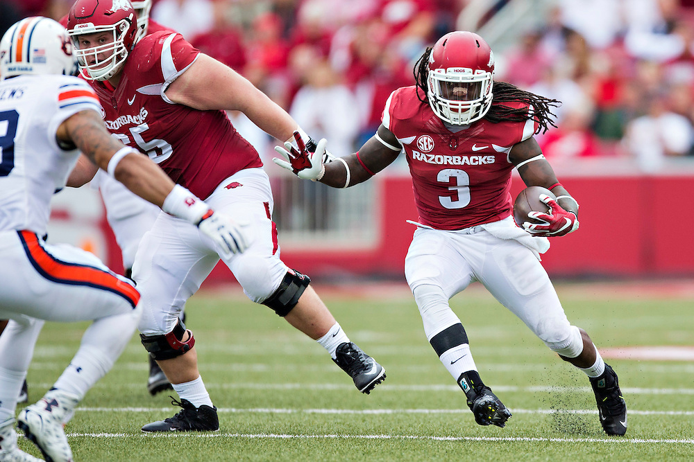 FAYETTEVILLE, AR - OCTOBER 24:  Alex Collins #3 of the Arkansas Razorbacks runs the ball during a game against the Auburn Tigers at Razorback Stadium on October 24, 2015 in Fayetteville, Arkansas.  The Razorbacks defeated the Tigers in 4 OT's 54-46.  (Photo by Wesley Hitt/Getty Images) *** Local Caption *** Alex Collins