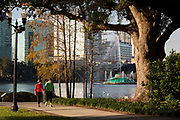 Elderly walkers on the path at Lake Eola Park in Orlando, Florida. Lake Eola Park is located in the heart of Downtown Orlando and home to the Walt Disney Amphitheater.