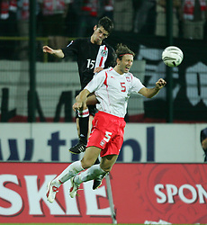 WARSAW, POLAND - WEDNESDAY, SEPTEMBER 7th, 2005: Wales' Richard Duffy and Poland's Kamil Kosowski during the World Cup Group Six Qualifying match at the Legia Stadium. (Pic by David Rawcliffe/Propaganda)