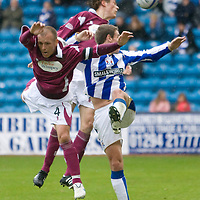 Kilmarnock v St Johnstone.....24.10.09<br /> Jody Morris and Murray Davidson in an aerial tussle with Craig Bryson<br /> Picture by Graeme Hart.<br /> Copyright Perthshire Picture Agency<br /> Tel: 01738 623350  Mobile: 07990 594431