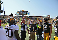 September 29 2012: Referee Dennis Lipski performs the coin toss before the start of the NCAA football game between the Minnesota Golden Gophers and the Iowa Hawkeyes at Kinnick Stadium in Iowa City, Iowa on Saturday September 29, 2012. Iowa defeated Minnesota 31-13 to claim the Floyd of Rosedale Trophy.