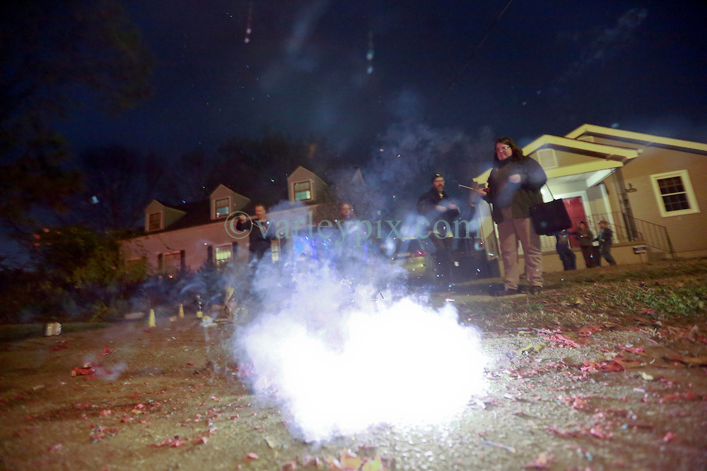 31 December 2014. New Orleans, Louisiana. <br /> Celebrating New year's Eve with friends.<br /> Photo; Charlie Varley/varleypix.com