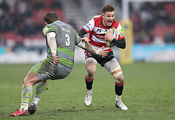 Gloucester's Billy Burns side steps Newcastle's Jon Welsh during the Aviva Premiership match at the Kingsholm Stadium, Gloucester.