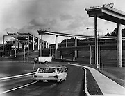 "A few loose ends of the freeway stood on their supporting structures waiting to be ""plugged into"" future construction. The I-90 interchange stubs, as seen from South Connecticut Street and Airport Way South, seemed to grope in space without purpose. (Ron DeRosa / The Seattle Times, 1966)"