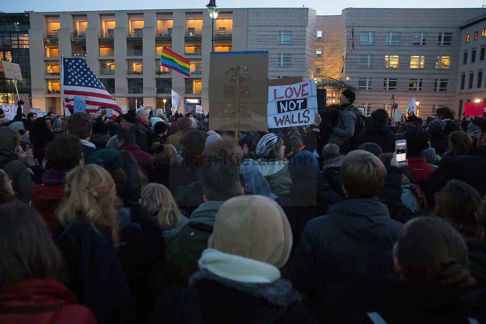 Berlin, Germany - 12.11.2016<br /> <br /> Protest in front of the US embassy in Berlin against the US president-elect Donald Trump. Hundreds of people, many of them US-American citizens abroad, join the Anti-Trump rally at the Brandenburg Gate.<br /> <br /> Protest vor der US-Botschaft in Berlin gegen den neugewaehlten US-Praesidenten Donald Trump. Hunderte Menschen, darunter viele US-Amerikaner, beteiligten sich an der Kundgebung die am Brandenburger Tor stattfand.<br /> <br /> Photo: Bjoern Kietzmann