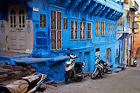Houses with blue walls with motorbikes in the streets, Jodhpur, India. Exotic places fine art photography prints for sale