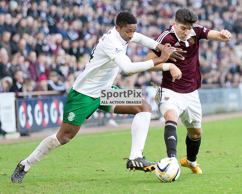 Hearts v Hibernian Scottish Championship 3 January 2015; Hibernian's Dominique Malonga and Heart's attacking Callum Paterson fight for the ball during the Heart of Midlothian v Hibernian Scottish Championship match played at Tynecastle Stadium, Edinburgh;
