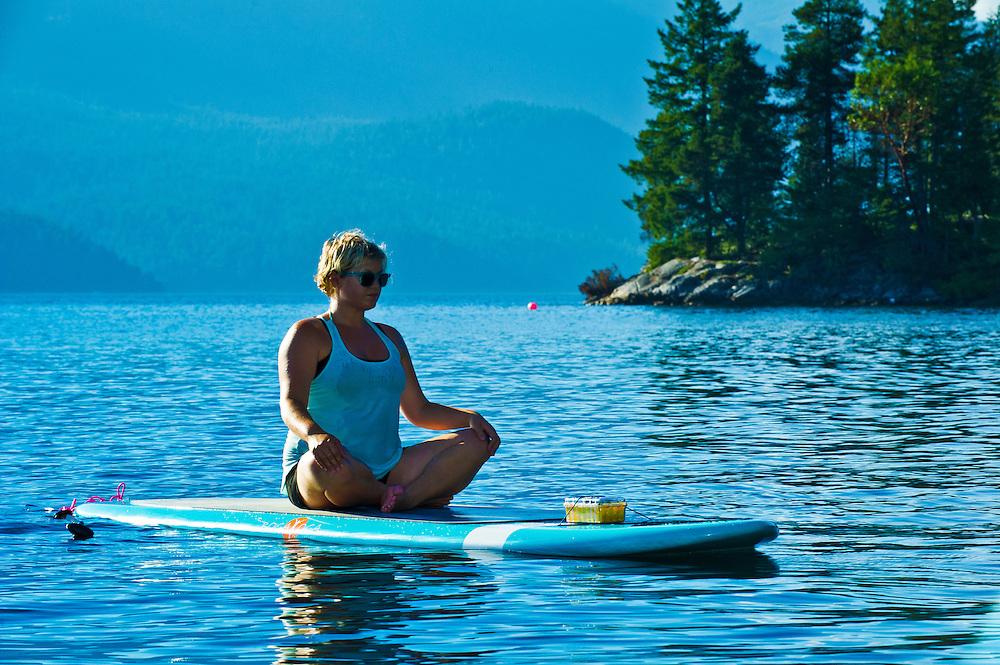 Yoga class on a Paddle Board, onthe Sunshine Coast.