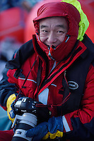 Mr Xie Jianguo, Whale watching and photography visitor/ecotourist from China on boat outside Senja, Troms county, Norway, Scandinavia