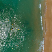Aerial top down view seascape, of Praia Porto de Mos (Beach and seaside cliff formations along coastline of Lagos city), famous destination in Algarve. South Portugal.