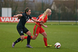 NEWPORT, WALES - Friday, April 1, 2016: Wales' captain Elise Hughes in action against the Republic of Ireland's Lucia Lobato during Day 1 of the Bob Docherty International Tournament 2016 at Dragon Park. (Pic by David Rawcliffe/Propaganda)