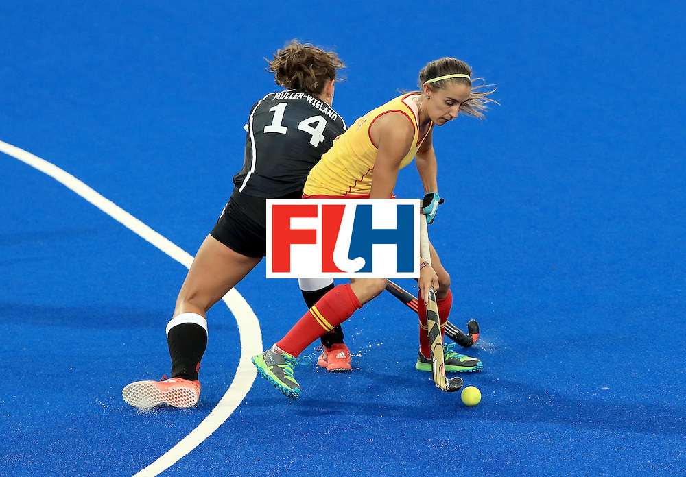 RIO DE JANEIRO, BRAZIL - AUGUST 11:  Carola Salvatella #8 of Spain attempts to run past Janne Muller-Wieland #14 of Germany during a Women's Preliminary Pool A match at the Olympic Hockey Centre on August 11, 2016 in Rio de Janeiro, Brazil.  (Photo by Sam Greenwood/Getty Images)