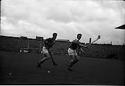 04/09/1960<br /> 09/04/1960<br /> 4 September 1960 <br /> All-Ireland Final: Tipperary v Wexford at Croke Park, Dublin.<br /> Seán McLoughlin (Tipperary) and John Mitchell (Wexford) near Wexford's goal.